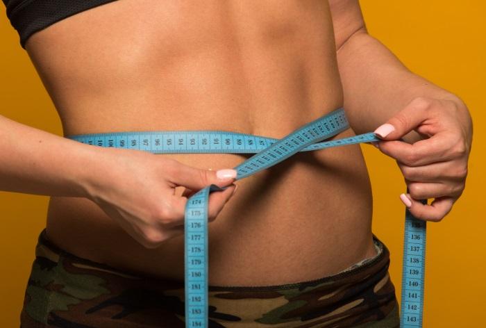 coconut oil helps lose abdominal fat