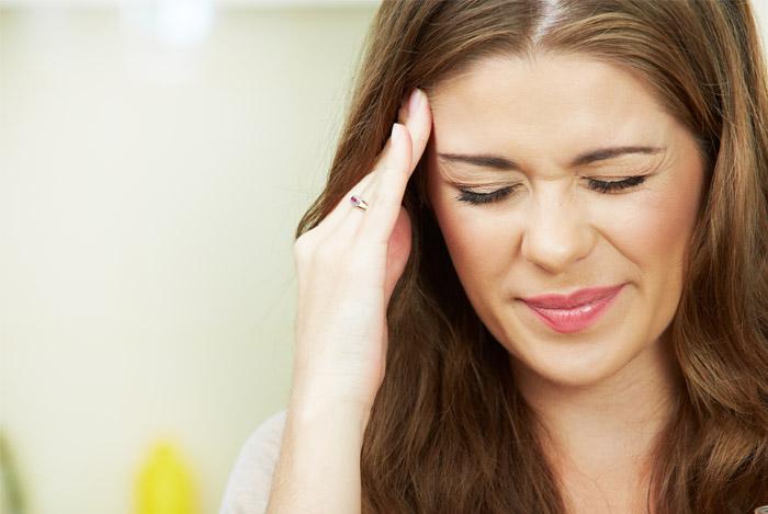 woman-headache-cocnut-cure